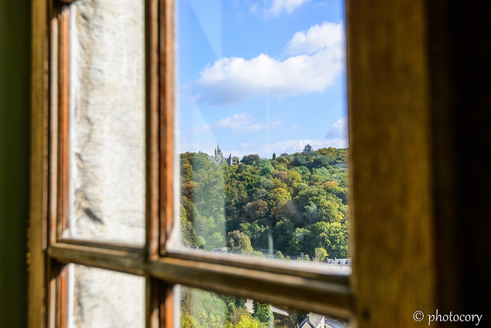 Another castle can be seen through the window