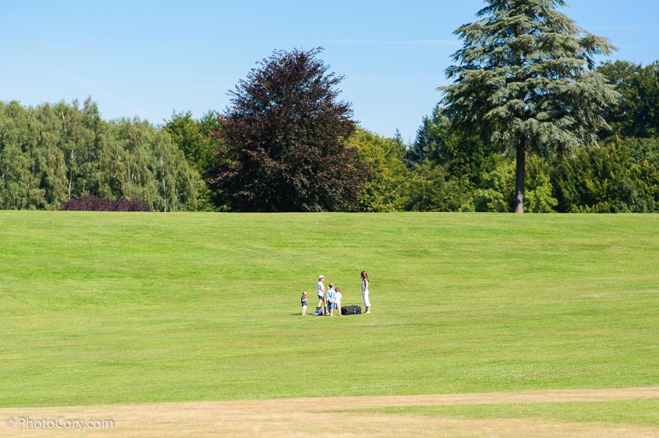 family on grass, summer, blue sky, belgium ,la hulpe