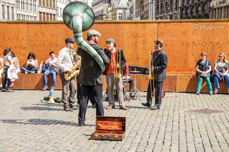 Street musicians in Antwerp, with a peculiar trumpet