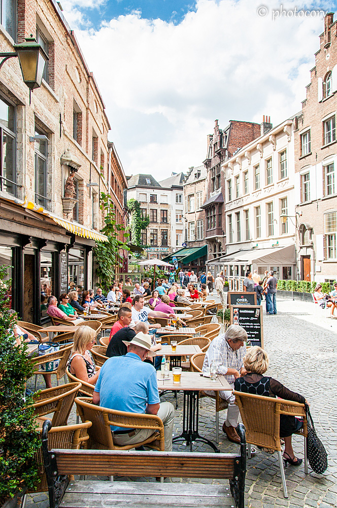 Summertime in Anvers, people enjoying a cold beer, a cup of coffee and some people watching