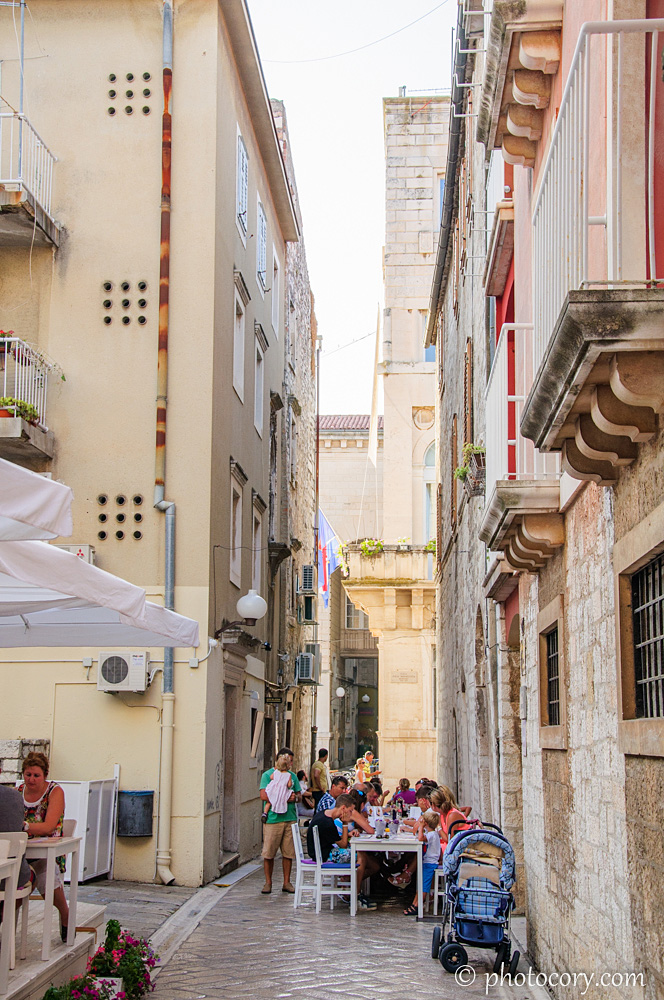 A narrow alley with restaurants