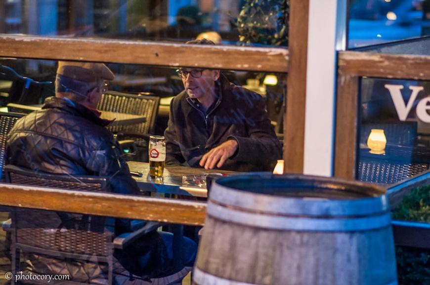Men discussing in a pub in Hasselt