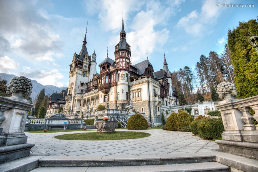 The front garden of Peles Castle and Mountains in the back