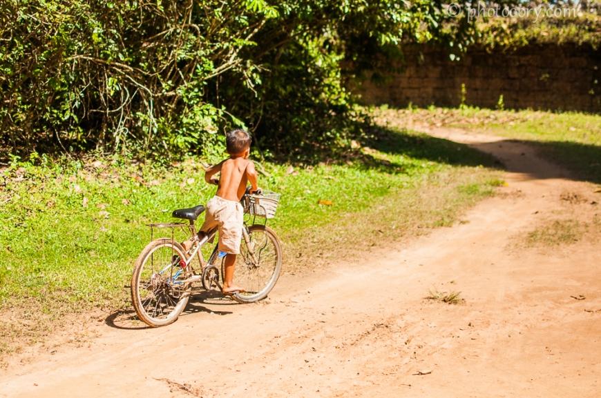 boy on bike in Cambodia