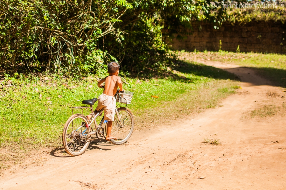 boy on bike in Cambodia