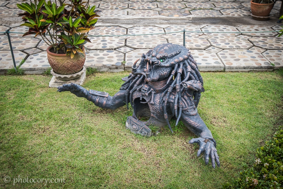 Predator rising from the ground in the garden of the White Temple