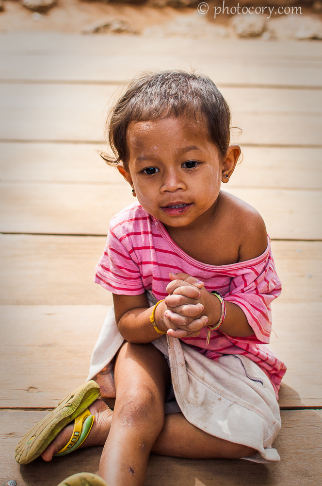 girl playing in cambodia temple