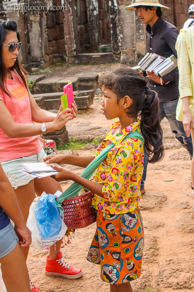 Girl selling postcards Cambodia