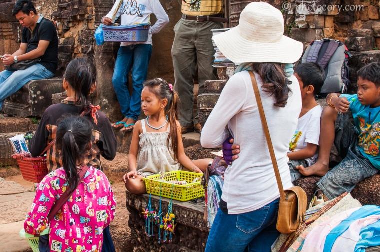 girl selling souvenirs Cambodia