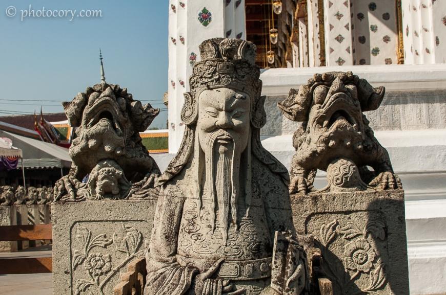 wat arun bangkok sculptures