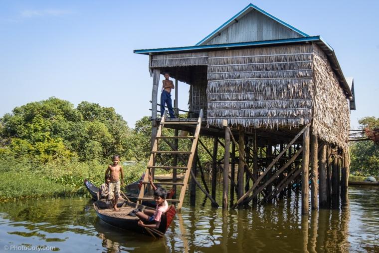 children on boat floating village