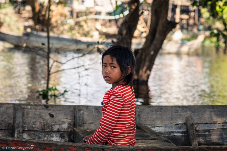 girl in boat flooded forest