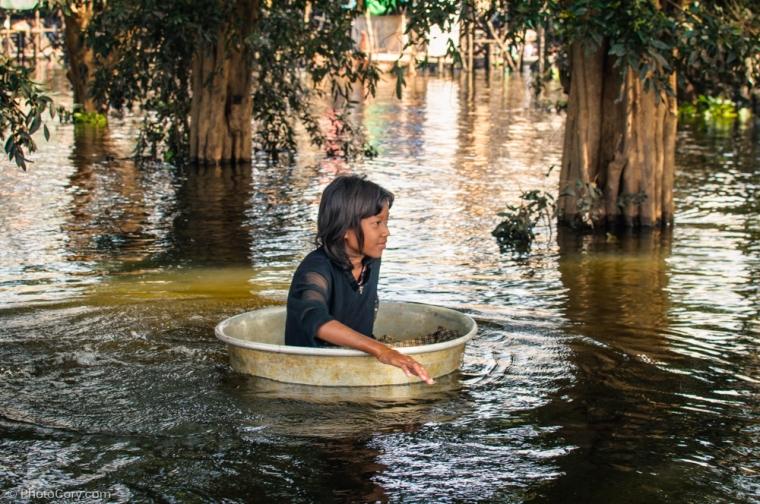 girl in water floating village
