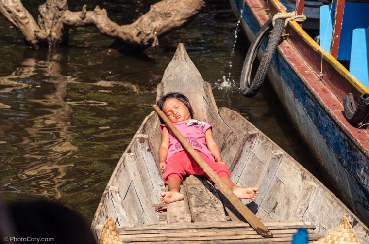 girl sleeping on boat cambodia