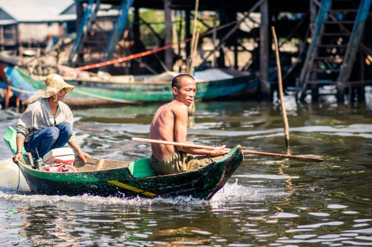 men on boat kompong phluk