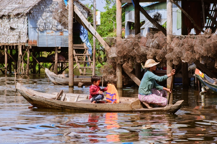 people on boat Floating village cambodia