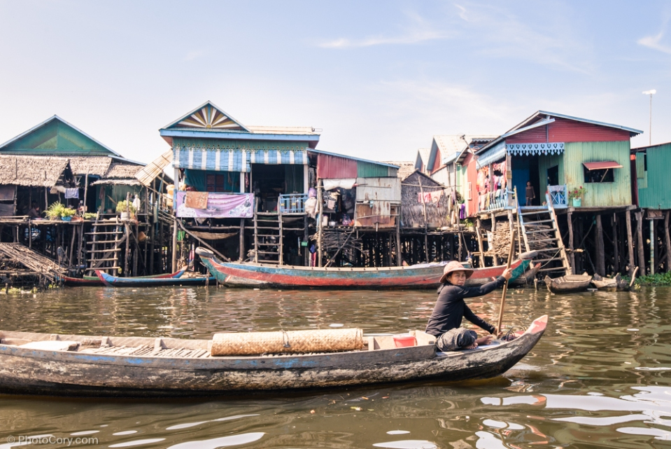 woman on boat floating village