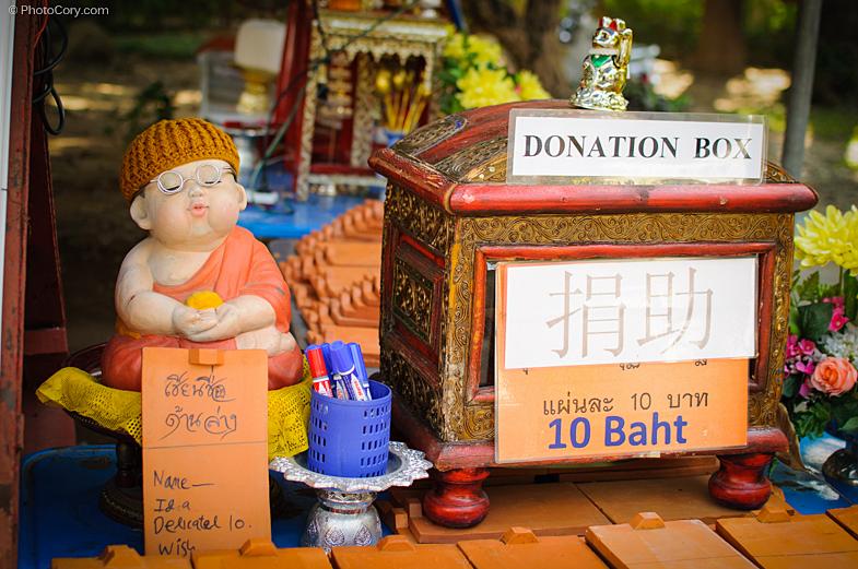 donation box temple thailand