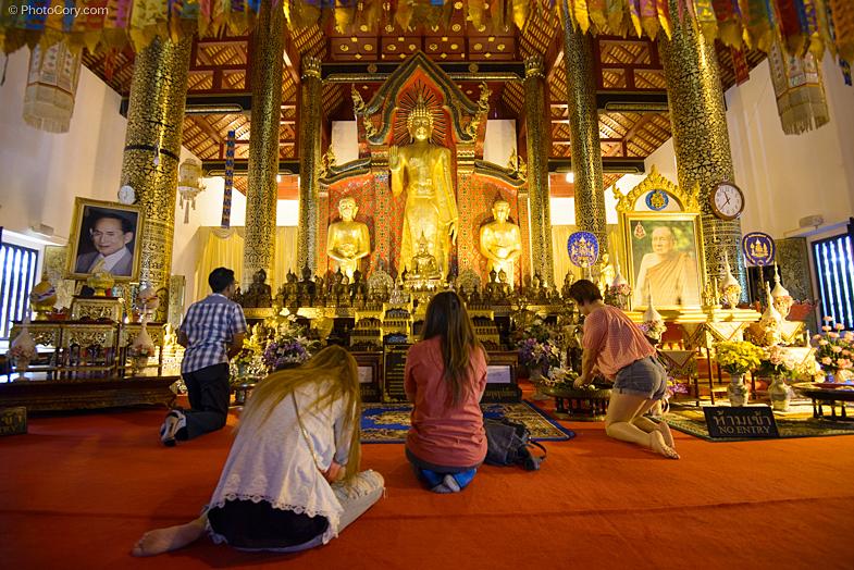 people praying temple thailand