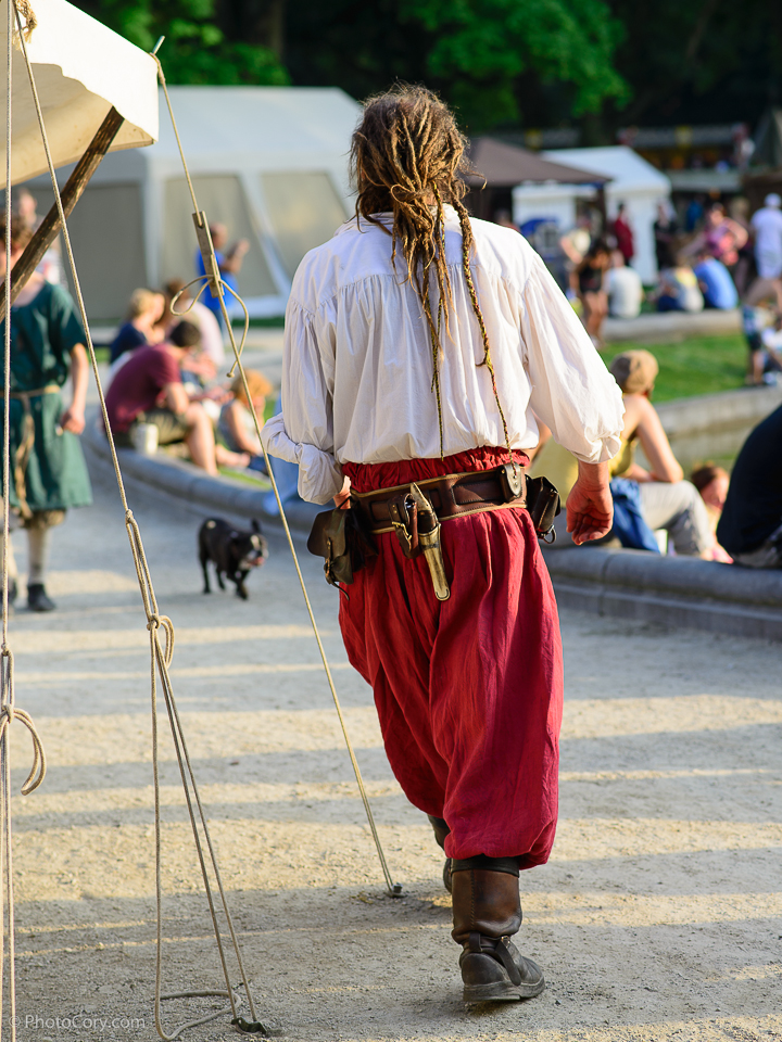 man with locks hair and red pants medieval