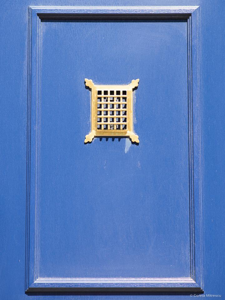 a part of a blue entrance door