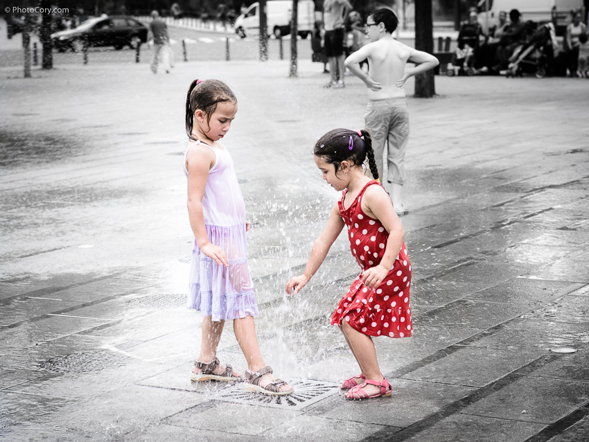 children wet in water fountain