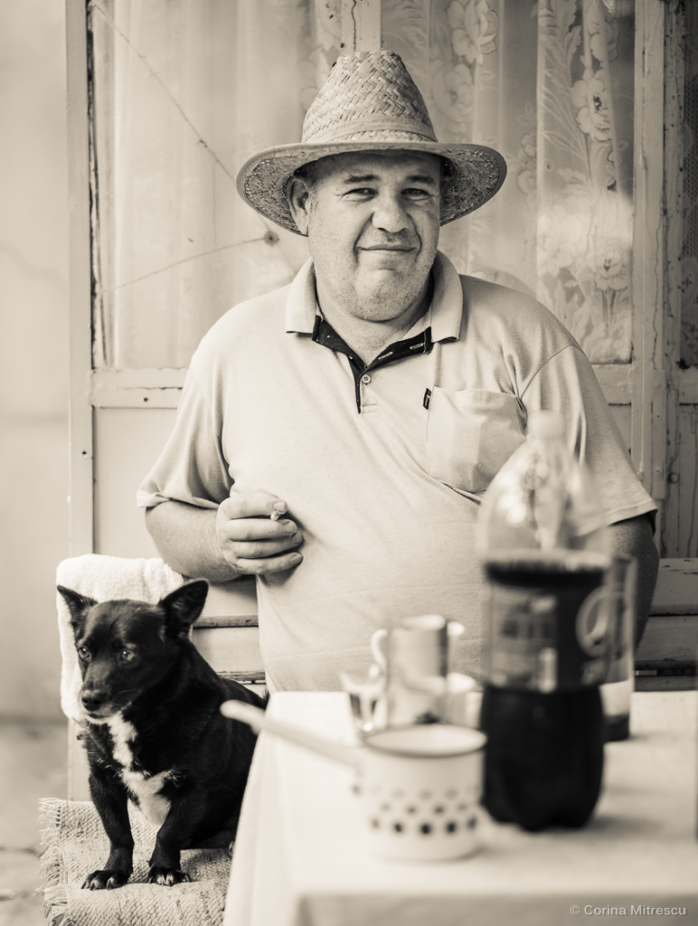 man with cigarette and dog