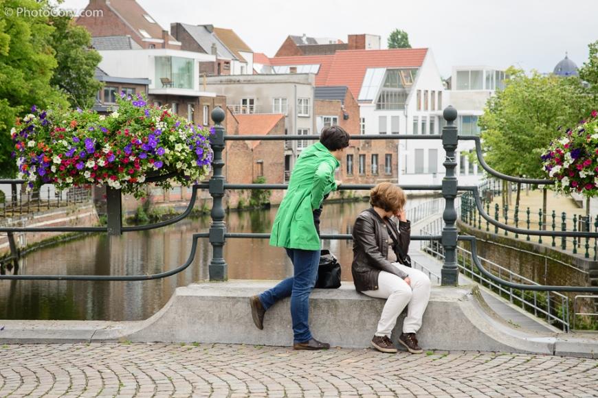 two women looking at Dijle River Mechelen Belgium