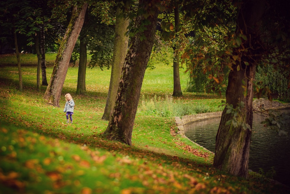 little girl in forest lake trees