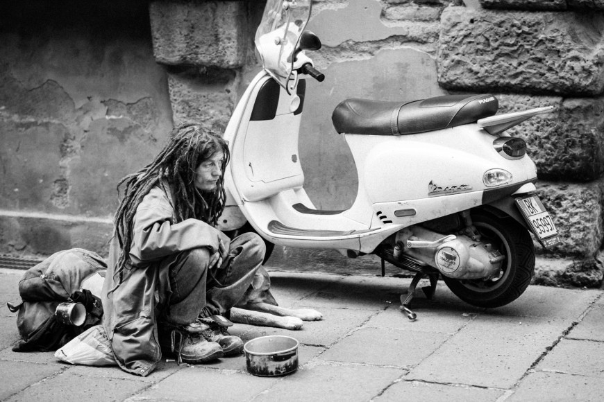 beggar and his dog