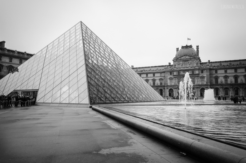 the glass pyramid entrance at louvre, paris, france