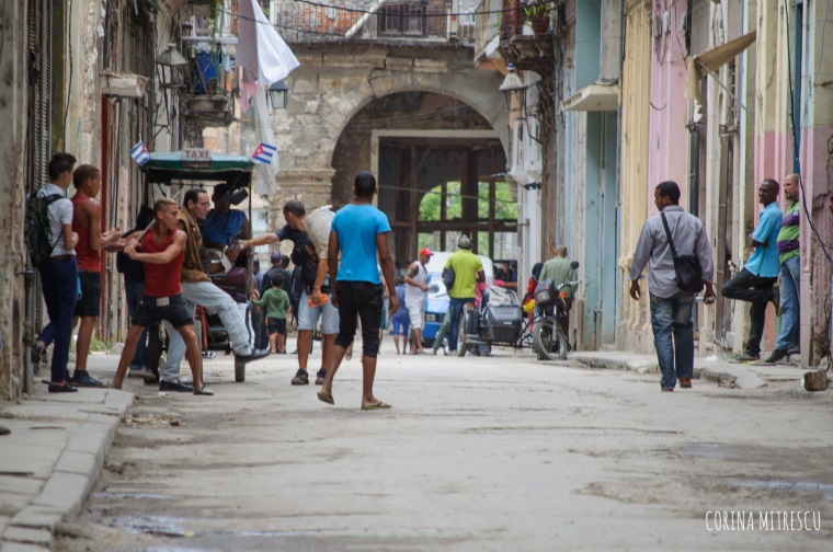 boys playing baseball on the streets of havana