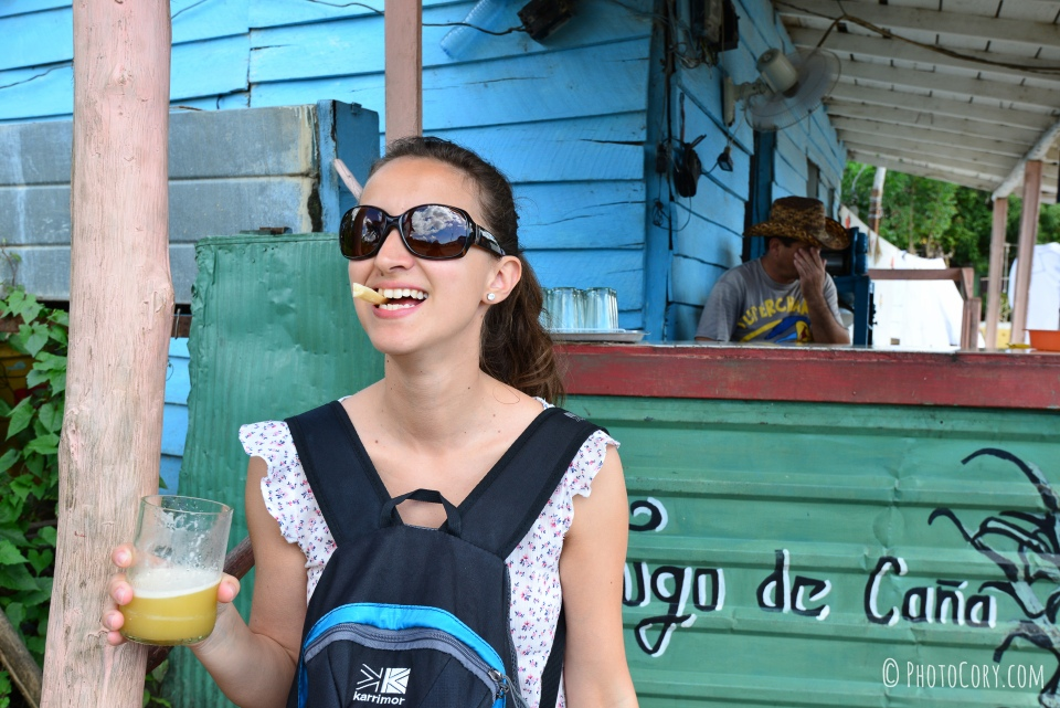 drinking sugarcane juice