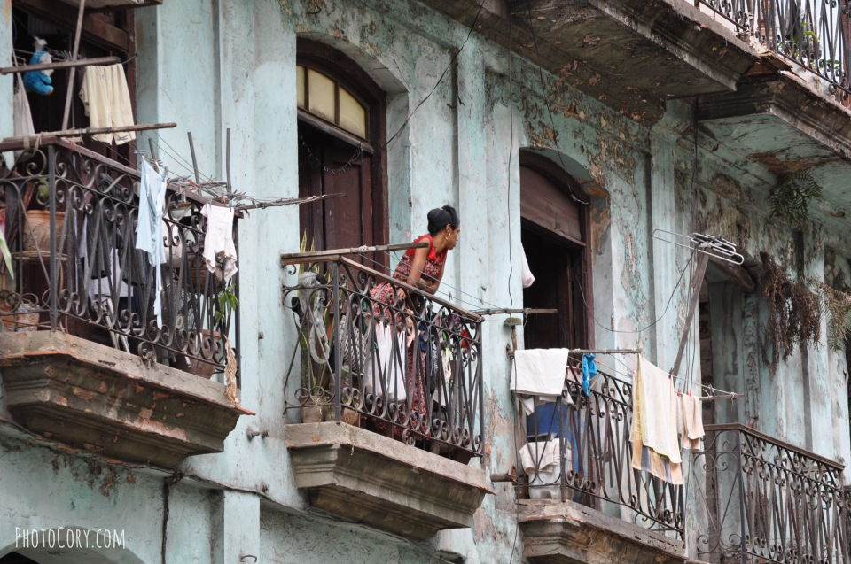 people balcony havana