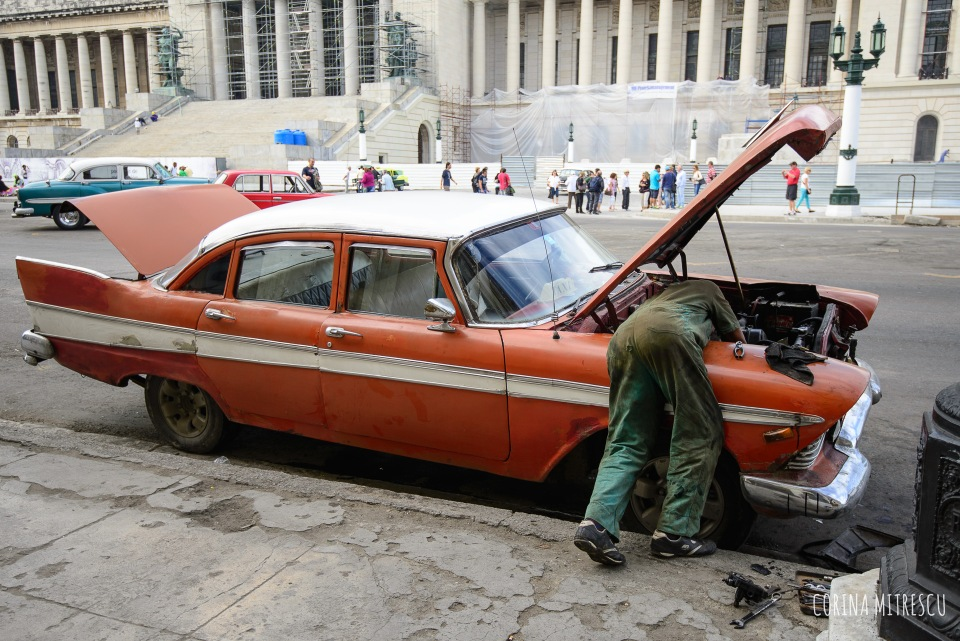 repairing old car in havana