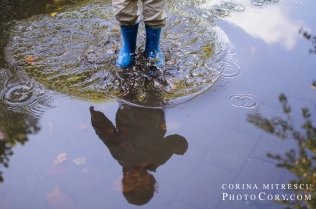 toddler in puddle